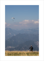 The hiker and the birdman (andyrousephotography) Tags: italy malcesine lakegarda mecca water sports aerial adrenaline junkies adventurist paragliding para glide wing solo tandem hiker walkers walking montebaldo cablecar morning mountains sunlight andyrouse canon eos 5d mkiii