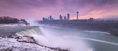 Niagara Falls Sunset from NY (Mike Ver Sprill - Milky Way Mike) Tags: niagara falls niagaras fury canada canadian new york america usa woman alone red coat standing still ominous snow cold winter beautiful long exposure clouds cloudy mist fog water vaper smooth waterfall fine art photography erosion landscape portrait fotodiox wonderpana sunset sunrise stacking stack panorama pano ny