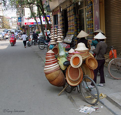 """Vendor of hats in Hanoi • <a style=""""font-size:0.8em;"""" href=""""http://www.flickr.com/photos/23163398@N00/32776686693/"""" target=""""_blank"""">View on Flickr</a>"""