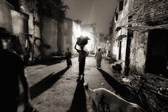 Oniric night scene, Kolkata (paola ambrosecchia) Tags: street night dark people kolkata india asia movement blackandwhite monochrome biancoenero shadow men dog amazing sky walking beautiful city citylife