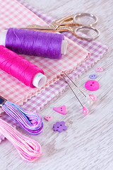 Sewing items with a check fabrics, buttons, thread and pins (♥Oxygen♥) Tags: thread pin closeup clothing pink violet craft tool cloth fabric macro bobbin design color sew work sewing tailor buttons embroidery tailoring fashion needlework cotton needle stitch hobby repair textile material supplies equipment texture colorful set background pattern leisure cushion dressmaker darning needlecraft seamstress objects dressmaking woden table coil