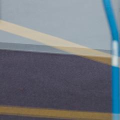 blue, yellow, gray (zeh.hah.es.) Tags: scheibe fenster window spiegelung reflection grau gray grey blau blue gelb yellow flughafen airport zurichairport zürichflughafen parkplatz parking ktzh kloten schweiz switzerland