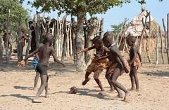 Himba children playing football - a village in Kaokoland, Namibia. (One more shot Rog) Tags: himba himbatribe himbavillage himbapeople kaololand namibia safari etosha opuwo tribe tribal village africanvillage footy football africanfootball onemoreshotrog