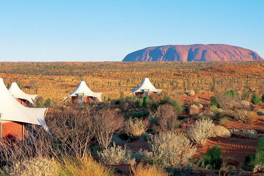 Luxury glamping with Australia's famous Uluru in the distance