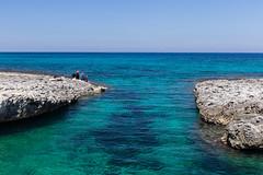 Fisherman near Baia dei Turchi in Otranto (Tim&Elisa) Tags: puglia italy otranto water mediterraneansea baiadeiturchi turquoise