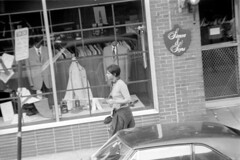 h3-68 15 (ndpa / s. lundeen, archivist) Tags: nick dewolf nickdewolf bw blackwhite photographbynickdewolf film monochrome blackandwhite city summer 1968 1960s 35mm boston massachusetts candid streetphotography citylife streetlife people youngpeople beaconhill charlesstreet sidewalk pedestrians store shop business window windows storewindow simonsons clothingstore street car vehicle automobile parkedcar door woman youngwoman pedestrian sign signs menssuits tailor tailors cleansers