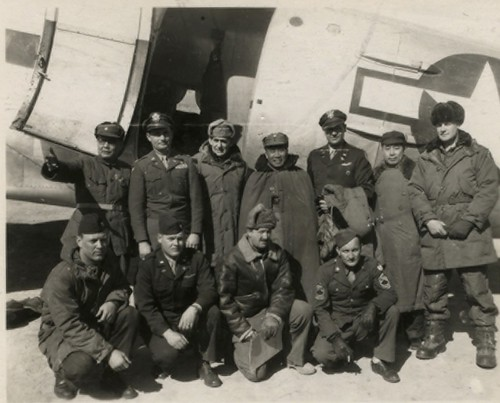 Group photo showing those who greeted plane and those who arrived on plane. L. to R. standing: Gen. Yeh, Col. Stanley (pilot), Col. Frank Ward, former chief of staff, American ranch, Gen. Chu Teh, Commander all Communist Forces, Col. Morris Martin, PRO, G