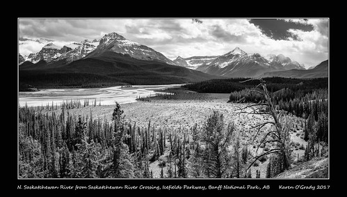 The North Saskatchewan River with Mt. Epaulette (L), Kaufmann Peaks, Mt. Sarbach, Howse Pass, Mt. Outram, Mt. Forbes, Messines Mountain and Mons Peak (R) from Saskatchewan River Crossing Viewpoint, Icefields Parkway, Banff National Park