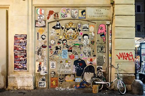 Roma. Trastevere. Street art-sticker art by The Hat Kid, K2m, OralProNobis, Cheyoda-booyakah22, BKC, Cara Carmina, Em-Rx, Narcossist, Wuarky, Merioone, Dirk, Guaro, Drew, Blackheart.boy, Cris Gucci, Davis Lives, Jah, Heart Craft, Molecola Blu...
