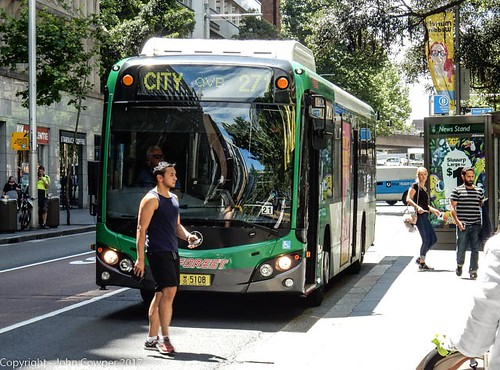 Forest Coachlines - Mercedes, Fleet Number MO 5108 challenged by J-walking chap with iPhone, York Street, Sydney