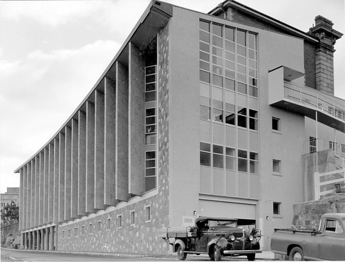 Utes parked outside State Library of Queensland during construction - William Street, Brisbane