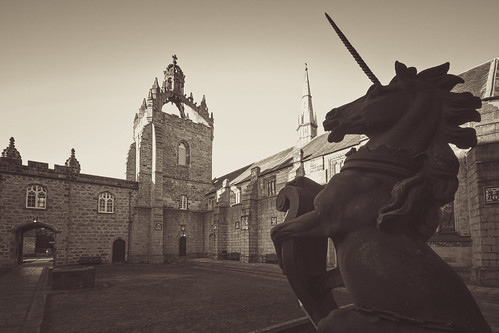 the Aberdeen unicorn rears up against the Kings College quad and chapel, fine art black & white. University of Aberdeen, Aberdeen, Scotland