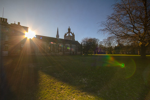 dazzling winter sun punches between Cromwell's Tower and King's College Chapel, University of Aberdeen, Aberdeen, Scotland.