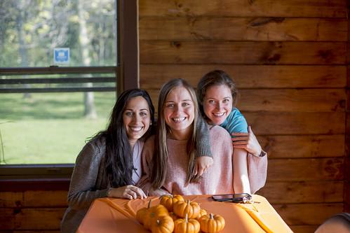 Sonya Narla, Izabela Subczynska and Lauren Hobbs getting ready to paint pumpkins at fall resident retreat