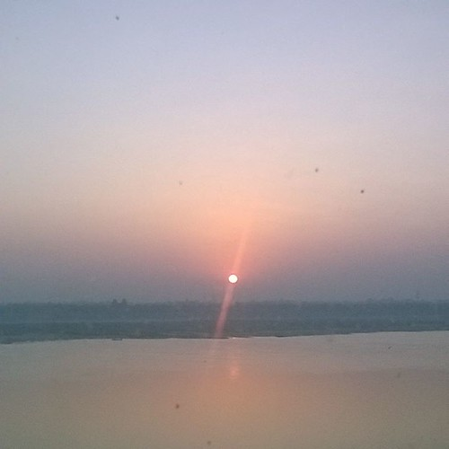 That red dot is the sun! #sunrise on the Ganga(#ganges river).