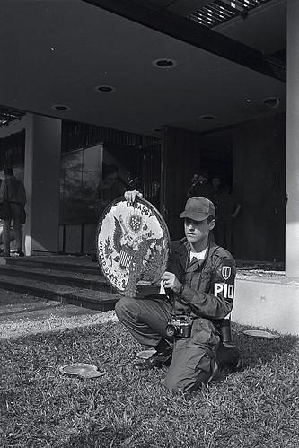 SAIGON 1968 - U.S. Soldier Holding Emblem