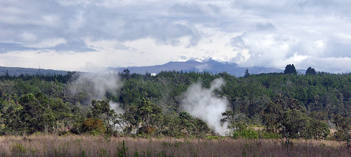 Active volcanic vents (foreground) with snow capped mountains (background)