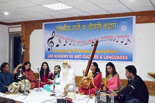 Artists presenting Dogri compositions in classical music at K L Saigal Hall of Cultural Academy.
