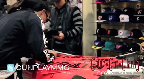 Gunplay signing autographs at Kanati Co.