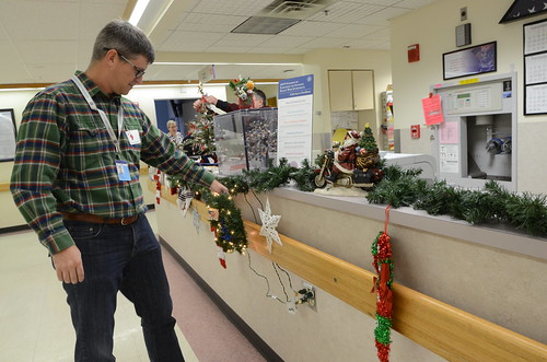 More than 150 GE Healthcare set up holiday decorations at Milwaukee VA Medical center, Friday, Dec. 2. The volunteers spread the cheer and tinsel across the entire campus pinning lights and glitter across ten floors and other VA buildings and wherever vet