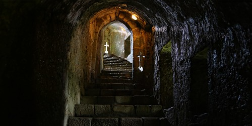 Old stone staircase with embrasures leads to the Feira Castle dungeons