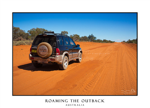 4wd on red sandy desert road in outback Australia