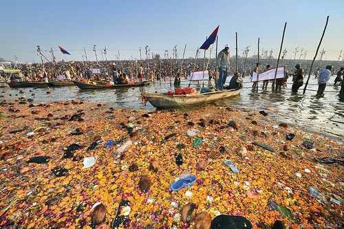 Pilgrims offers and garbage in River Ganges