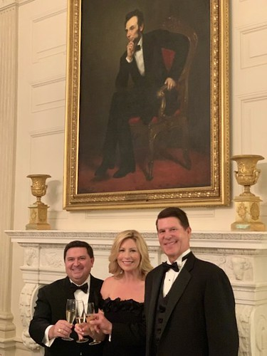 Keith and Metta Krach toast Sigma Chi with Stewart McLaurin in the East Room at The White House