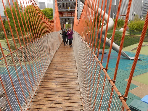 Having fun running on roped bridge in Maggie Daley Park