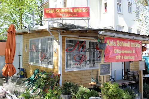 5023 Bilder aus dem Hamburger Stadtteil Billbrook - Asia Schnell Imbiss mit vergitterten Fenstern an der Straße Billbrookdeich.