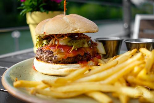 Burger w/ cheddar, gochujang ketchup, pickled bok choy, fried ramen - Table 9