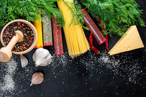 The concept of cooking - raw ingredients on a black background