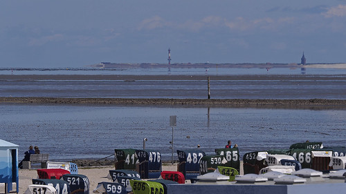 Southern German waddensee between Neuharlingersiel 'beach' in the foreground and Wangerooge island at the horizon.