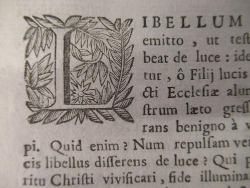 1689 floriated initial