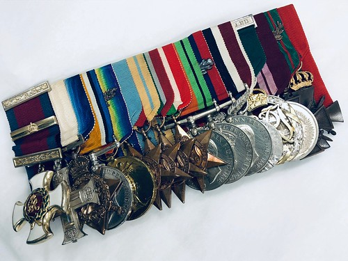 A very serious set of medals representing many years of service and bravery. Awarded to Major General Sir Harold Barrowclough KCMG, CB, DSO and bar, MC, ED, PC. 17 medals in total, court mounted. 2018.63.3