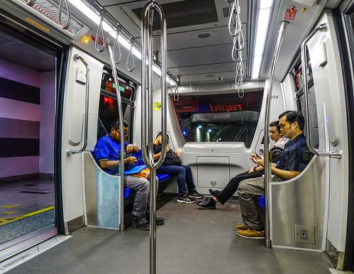 People sitting in LRT train