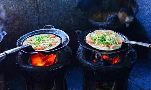 Cooking Vietnamese traditional seafood pancake