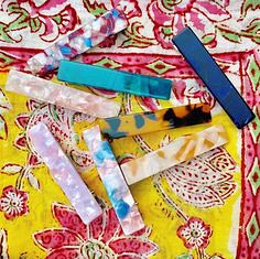 Beach day vibes. Indian cotton sarongs and awesome alligator clip acrylic swirl barrettes. Keep it cool. Both available online and in-store!