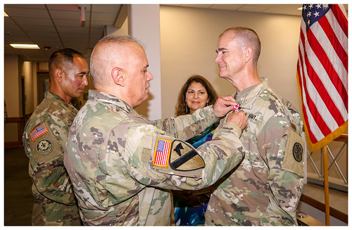 Col. Rafael Caraballo, Commander of the Dental Health Command-Central  presenting the Meritorious Service Medal to Lt. Col. Hambrice