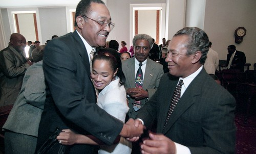 Henry Frye, his granddaughter Whitney Frye, Rev. Howard Chubbs, Governot James B. Hunt, at Hunt's announcement that Frye will become next chief justice of the NC Supreme Court, 2 August 1999, photos by Scott Sharpe