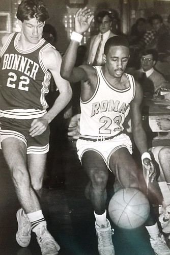 In 1986, Roman's Kevin Cofield chases a ball along the sideline with Bonner's John Roe in pursuit. Standing is Roman coach Barry Brodzinski. Over Cofield's left shoulder is Barry's long-time successor, Dennis Seddon. Photo by Bob Laramie.