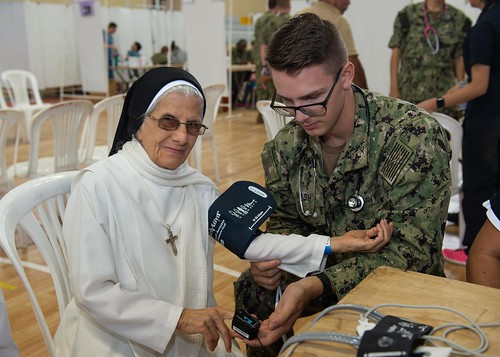 A Sailor takes a patient's vitals in Manta, Ecuador, June 30, 2019.
