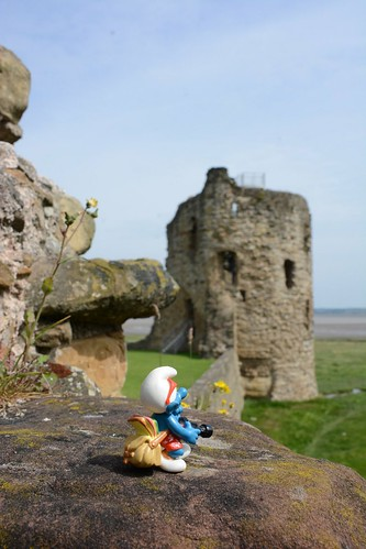 Travel smurf looking at the east tower of Flint castle
