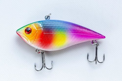 Colorful fish-lure for spinning on a white background