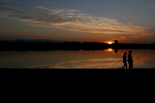 Couple walking past sunset, Lake Calhoun / Bde Maka Ska