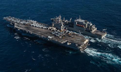 USS Ronald Reagan sails alongside USNS Matthew Perry during a replenishment-at-sea.