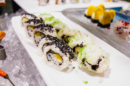 Sesame topped sushi on long plate