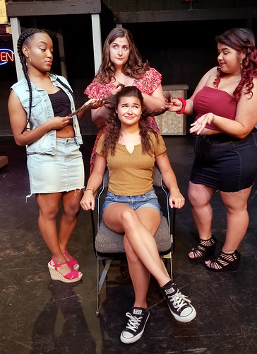"Vanessa (Lauren Taylor) and Daniela (Christina Duris) look at Nina (Rachel Dal Bianco)'s hair while Carla (Isabel Ellison) helps them in this salon scene from the musical ""In the Heights."""