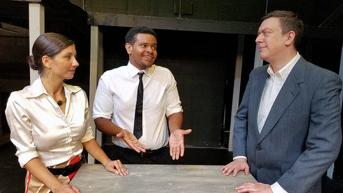 """Camila (Christina Flores Colbert) listens to Benny (Sterlin Johnson) while her husband Kevin (Frank Lopez) looks on in this scene from the musical """"In the Heights"""", to be presented by The Drama Group August 2-11."""