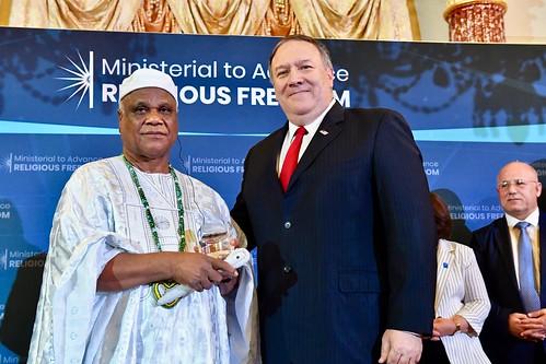 Secretary Pompeo Poses for a Photo With Ivanir dos Santos of Brazil